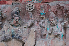 Dazu rock carvings,chongqing. Baodingshan temple in Dazu town, Chongqing, China,november 23,2012: Ancient Buddhist Hillside Rock Carvings dating back as far as Stock Photos