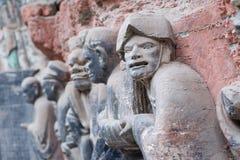 Dazu rock carvings,chongqing,china. Baodingshan temple in Dazu town, Chongqing, China,november 23,2012: Ancient Buddhist Hillside Rock Carvings dating back as Royalty Free Stock Photography