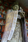 Dazu rock carvings,chongqing,china. The Dazu Rock Carvings are a series of Chinese religious sculptures and carvings, dating back as far as the 7th century A.D Stock Photo