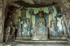 Dazu Rock Carvings in Chongqing Shu diagenetic Cliff Jade niches. 1.86 meters tall niches, 2.30 meters wide, 1.40 meters deep. Carved Jade like being the center Stock Images
