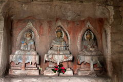 Dazu Rock Carvings in Chongqing Shu diagenetic niches like Cliff sanqing. Niches high 1.86 meters, 2.66 meters wide, deep 0.93 m. Three clear niche carved side Royalty Free Stock Photos