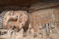 Dazu Rock Carvings. The Dazu Rock Carvings are a series of Chinese religious sculptures and carvings, dating back as far as the 7th century A.D., depicting and Stock Photos