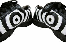 Dazzling eyes. Isolated photo of a pair of zebra design shoes with dazzling eyes Stock Photos