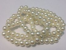 Dazzling pearls on white background stock images