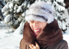 Dazzling sun. Girl screwing up her eyes on bright dazzling sun in winter Stock Photos