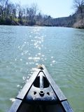 Dazzling sun on water. Canoeing on the Mountain Fork River. Near Broken Bow, Oklahoma. Morning sun creates dazzling diamonds, on the water. Natural beauty in royalty free stock image