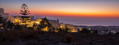 Dazzling sunrise on a Greek island. A dazzling sunrise early in the morning on the Greek island with a small lit villa in the foreground royalty free stock photos