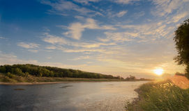 Dazzling sunset. Landscape with river royalty free stock photo