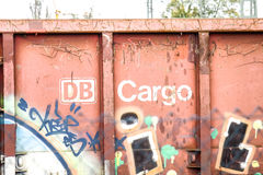 DB Cargo. Old, rusty, weathered and covered in Graffiti waggon of the Cargo branch of the german Deutsche Bahn Stock Photos