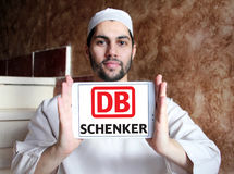 DB Schenker postal shipping company logo. Logo of DB Schenker postal shipping company on samsung tablet holded by arab muslim man Royalty Free Stock Photos