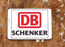 DB Schenker postal shipping company logo. Logo of DB Schenker postal shipping company on samsung tablet on wooden background Royalty Free Stock Photo