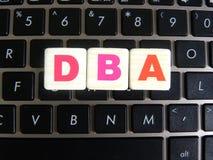 DBA аббревиатуры на предпосылке клавиатуры Стоковая Фотография RF