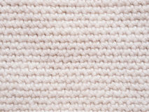 Débardeur tricoté de couleur claire comme fond Photos stock