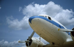 DC-3 on the ramp. Douglas DC-3- a vintage airliner -setting on the ramp under puffy clouds Royalty Free Stock Image