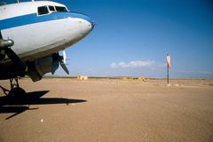 DC-3 in Somalia. DC-3 waiting at airstrip in Northern Somalia Royalty Free Stock Photos