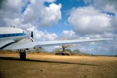 DC-3 in Somalia. DC-3 waiting by bush terminal for cargo and passengers in Somalia Stock Image