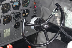 DC3 cockpit steering pilot. Cockpit steering of operational DC3 airplane with pilot hand Royalty Free Stock Photography