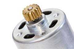 DC motor with gear. Closeup of powerful micro DC motor with cogwheel Stock Images