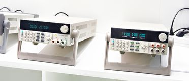 DC power supply lab devices. DC power supply devices for lab stock image