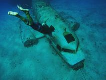 DC-3 wreck. Free-diving a DC-3 wreck in the Marshal islands stock photos