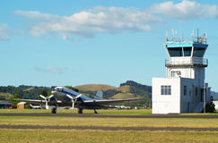 DC3 and Control Tower Royalty Free Stock Images