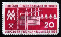DDR德国邮票显示工业体系纪念莱比锡春天市场,大约1959年 图库摄影