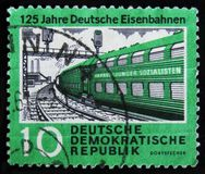DDR Germany postage stamp shows electric train, the series `The 125th Anniversary of Rail Roads`, circa 1960 Royalty Free Stock Photo