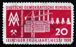 DDR Germany postage stamp shows the industrial complex to commemorate Leipzig Spring Fair, circa 1959. MOSCOW, RUSSIA - APRIL 2, 2017: A post stamp printed in Stock Photography