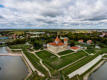 DDrone Aerial image of defence towers of Kuressaare Fortress with weather vane. Spring. Medieval fortification in. Saaremaa island, Estonia, Europe. Photo taken royalty free stock images