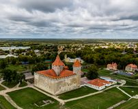 DDrone Aerial image of defence towers of Kuressaare Fortress with weather vane. Spring. Medieval fortification in. Saaremaa island, Estonia, Europe. Photo taken royalty free stock image