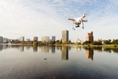 A dDrone Quadcopter Hoovers over Lake Merritt Oakland California. A Drone Quadcopter Hoovers over Lake Merritt Oakland California royalty free stock photography