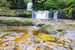 Ddwl Isaf waterfall on the Nedd Fechan River. Ddwl Isaf waterfall (Lower Gushing Fall) on the Nedd Fechan River along the Elidir trail in South Wales UK Stock Images