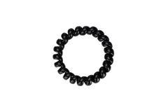 De één zwarte plastic scrunchy lente Royalty-vrije Stock Foto's