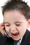 De aanbiddelijke Jongen die van de Baby in Kostuum in Cellphone schreeuwt Stock Foto