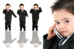 De aanbiddelijke Jongen van de Baby in Kostuum op Cellphone Stock Afbeelding
