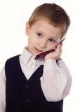 De aanbiddelijke Jongen van de Baby in Kostuum op Cellphone stock afbeeldingen