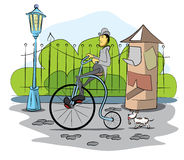 De aandrijving van de heer een retro fiets Royalty-vrije Stock Afbeelding