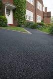 De aandrijving van het asfalt Stock Foto's