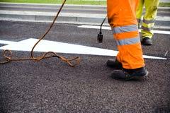 De aanleg van wegen en het schilderen Royalty-vrije Stock Foto's