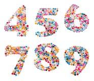 De aantallen die van kleurrijk worden gemaakt bestrooit Stock Afbeeldingen