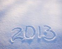 De aantallen van het nieuwjaar op de sneeuw Stock Afbeelding