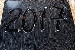 2017 de aantallen worden geschreven op de schuimoppervlakte Royalty-vrije Stock Foto's