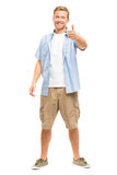 De aantrekkelijke jonge mens beduimelt omhoog volledige lengte op witte achtergrond Stock Fotografie