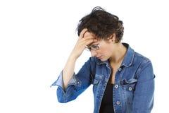 De aantrekkelijke jonge vrouw heeft een hoofdpijn Royalty-vrije Stock Foto's