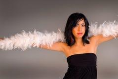 De aantrekkelijke latino vrouw in aantrekkingskracht stelt Stock Foto