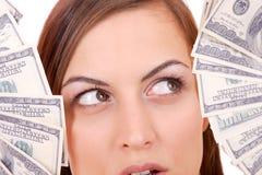 De aantrekkelijke vrouw neemt partij van 100 dollarsrekeningen Royalty-vrije Stock Foto