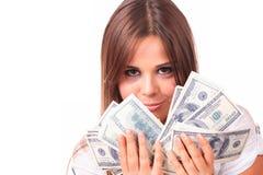 De aantrekkelijke vrouw neemt partij van 100 dollarsrekeningen Stock Afbeeldingen