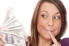 De aantrekkelijke vrouw neemt partij van 100 dollarsrekeningen Royalty-vrije Stock Afbeeldingen