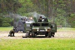 De aanval van militairen Stock Afbeeldingen