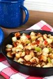 De Aardappels van het close-upontbijt in Koekepan Stock Foto